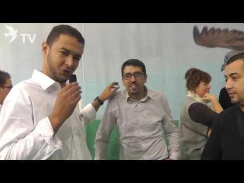 البطل حميد الشامخي والبطل مهدي عيسات في حوار مع رونفريد Röhnfried في المعرض العالمي للحمام الزاجل