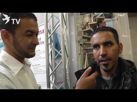 البطل عرفان رشيد في حوار مع رونفريد Röhnfried في المعرض العالمي للحمام الزاجل